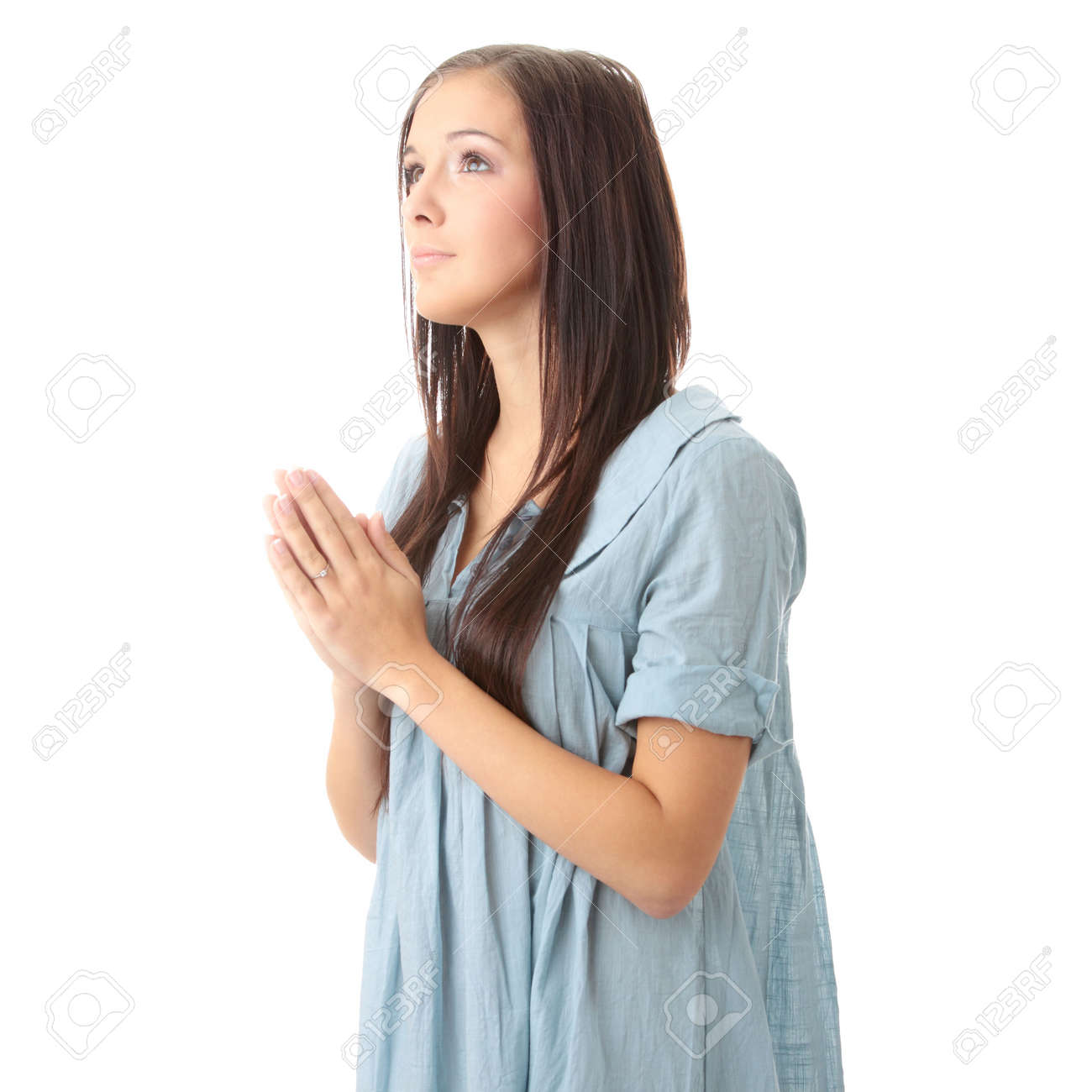 Closeup portrait of a young caucasian woman praying isolated on white background Stock Photo - 6439054