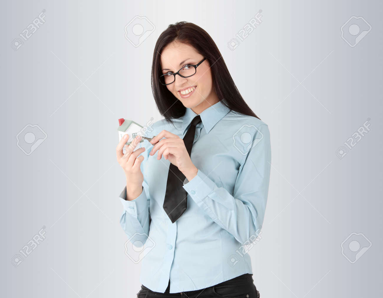 Young businesswoman  (real estate agent) with hose model and kays Stock Photo - 6475420