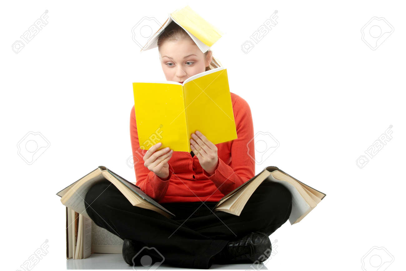 Young student woman with books all over her body, isolated on white Stock Photo - 6475436