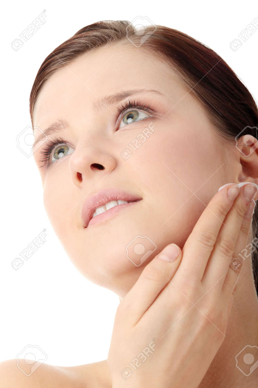 Woman applying moisturizer cream on face. Close-up fresh woman face. Stock Photo - 6599288