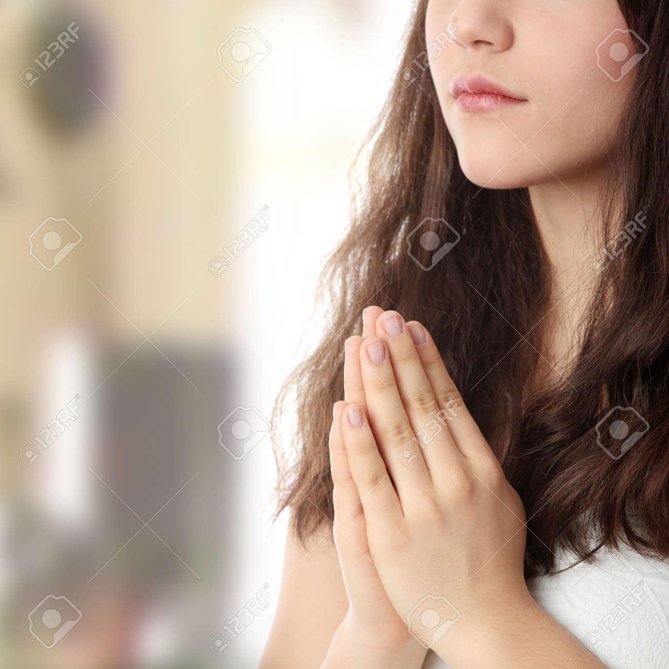 Closeup portrait of a young caucasian woman praying Stock Photo - 6932677