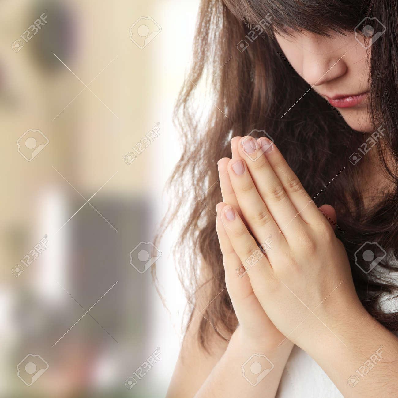 Closeup portrait of a young caucasian woman praying Stock Photo - 6932604