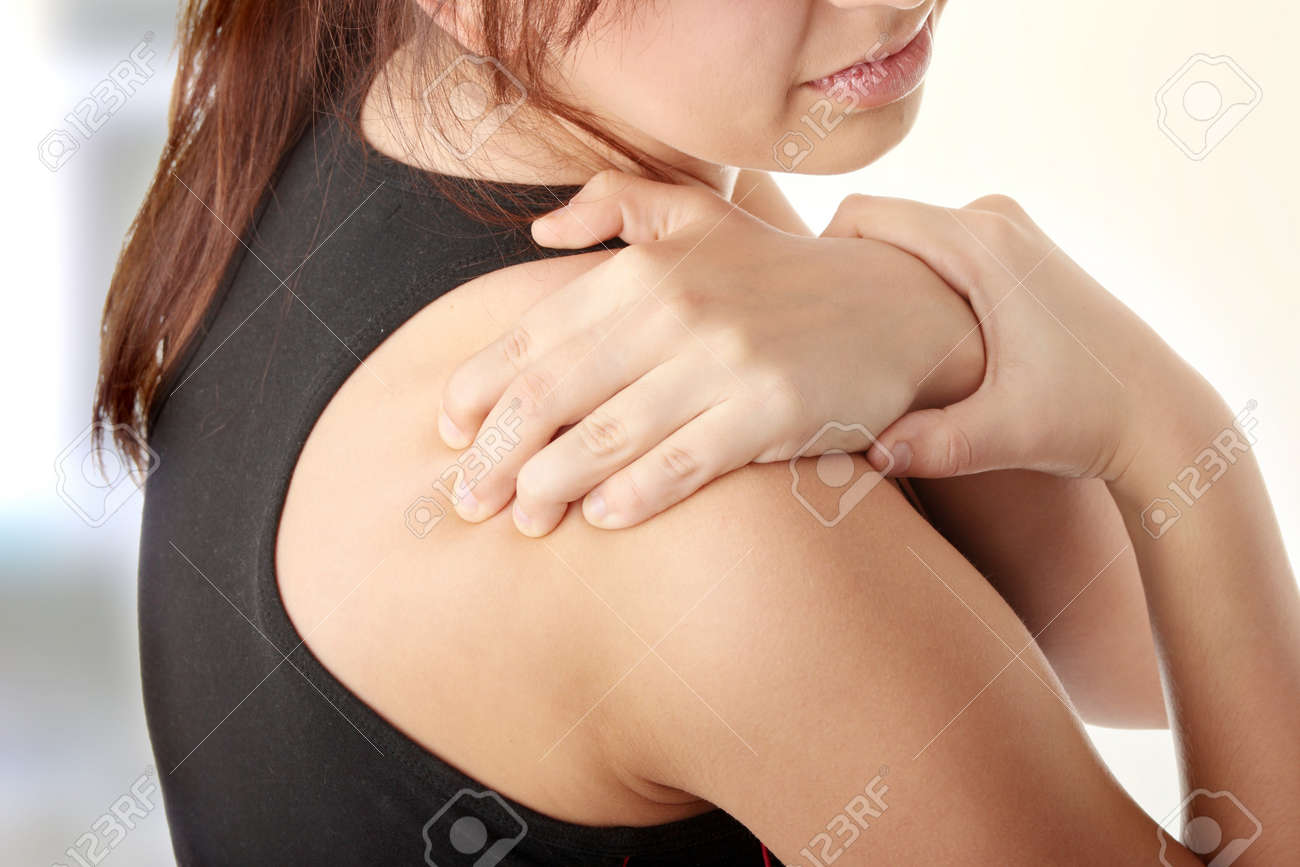 Young woman with pain in her back. Stock Photo - 6954824