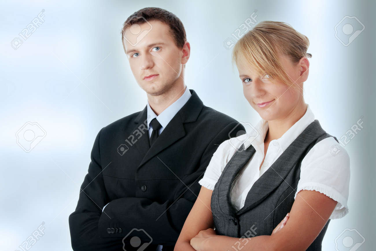 Young attractive business people isolated Stock Photo - 7816432