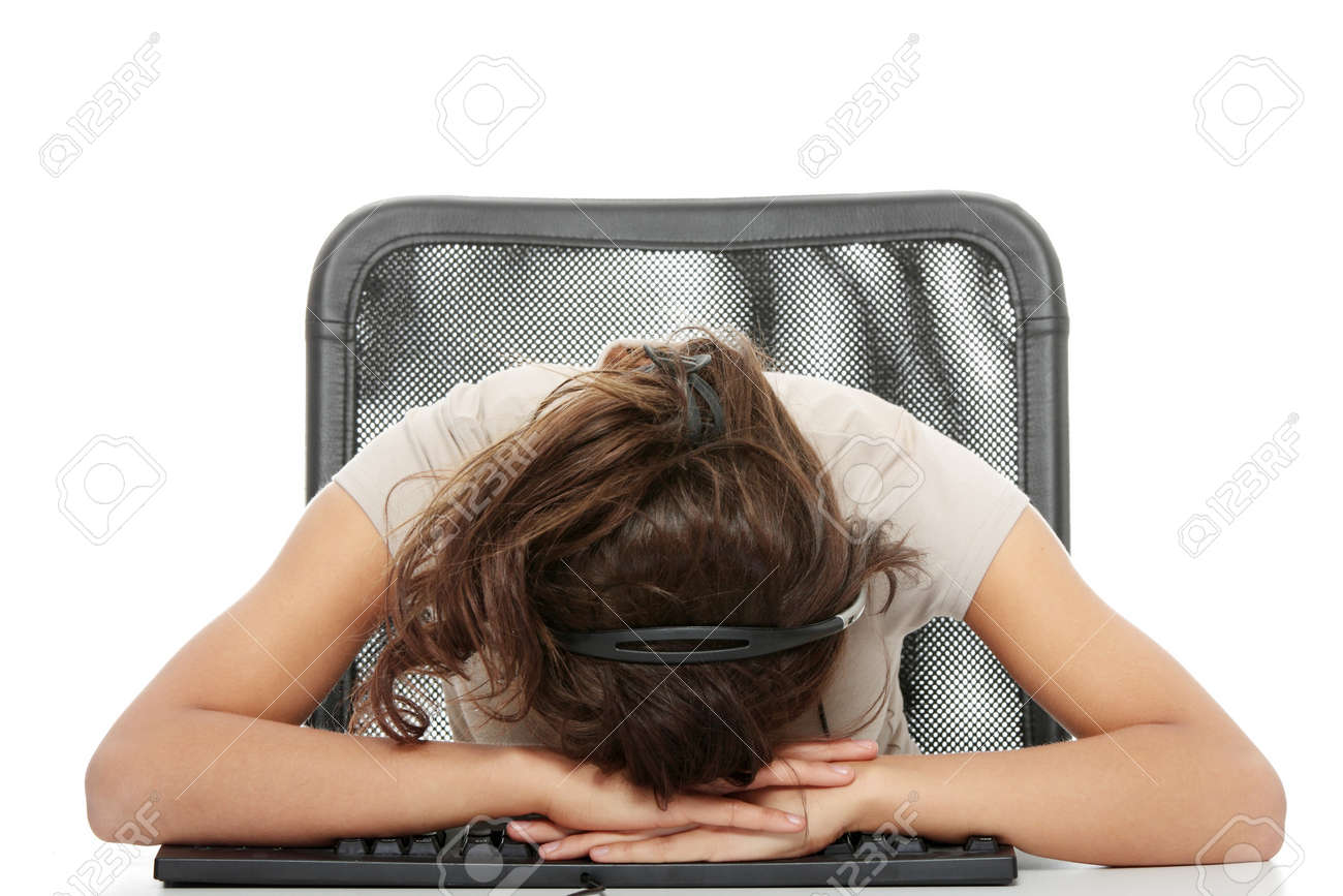 Young beautiful caucasian woman working in call center - tired Stock Photo - 6933157