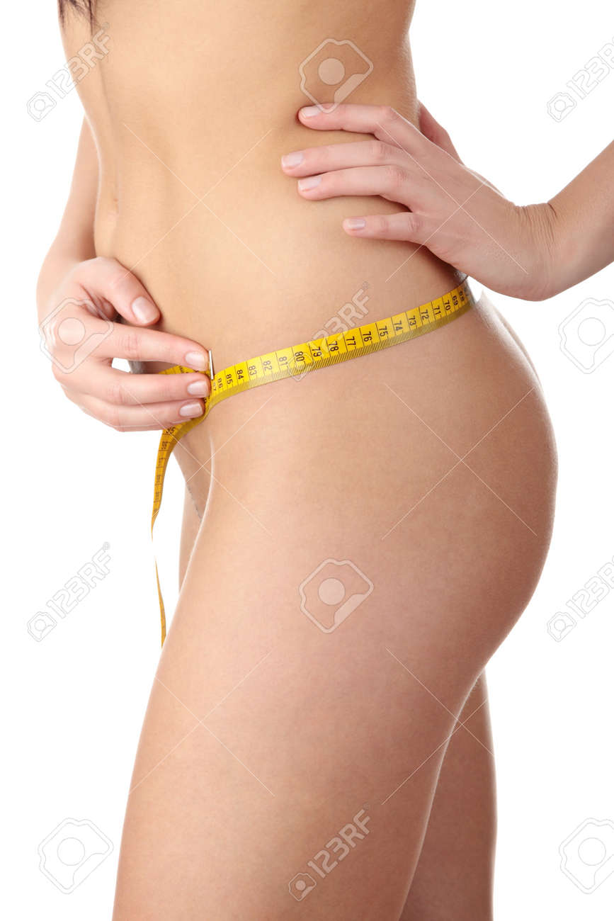 The beautiful girl measures her body on a white background. Healthy lifestyles concept. Stock Photo - 7042058