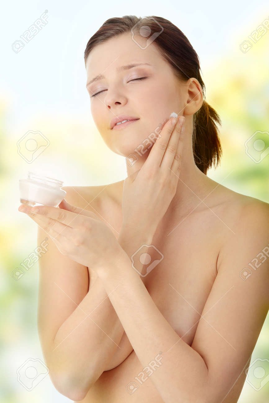 Woman applying moisturizer cream on face. Close-up fresh woman face. Stock Photo - 7509749