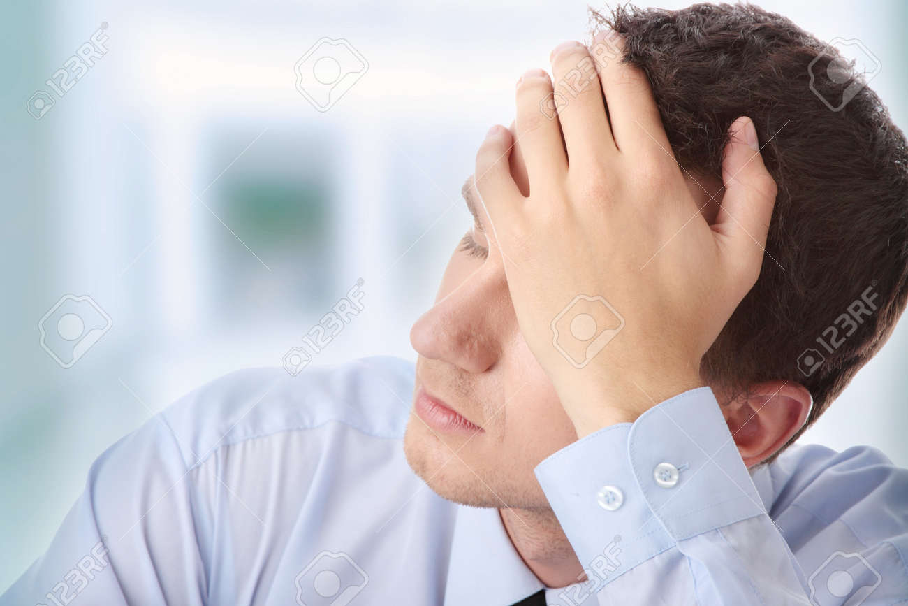 Businessman in depression with hand on forehead Stock Photo - 7821098