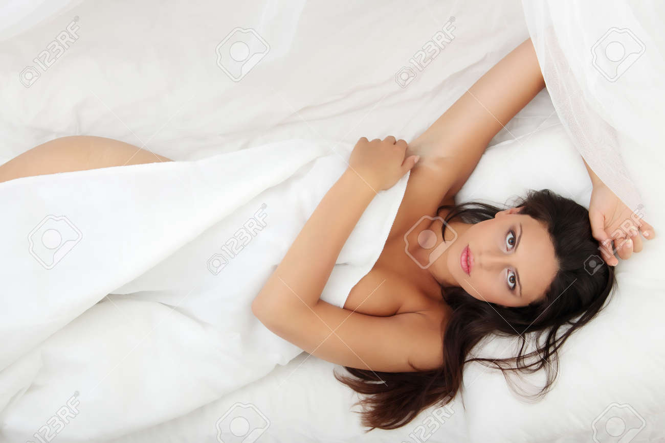 Closeup portrait of a cute young woman sleeping on the bed Stock Photo - 8048318