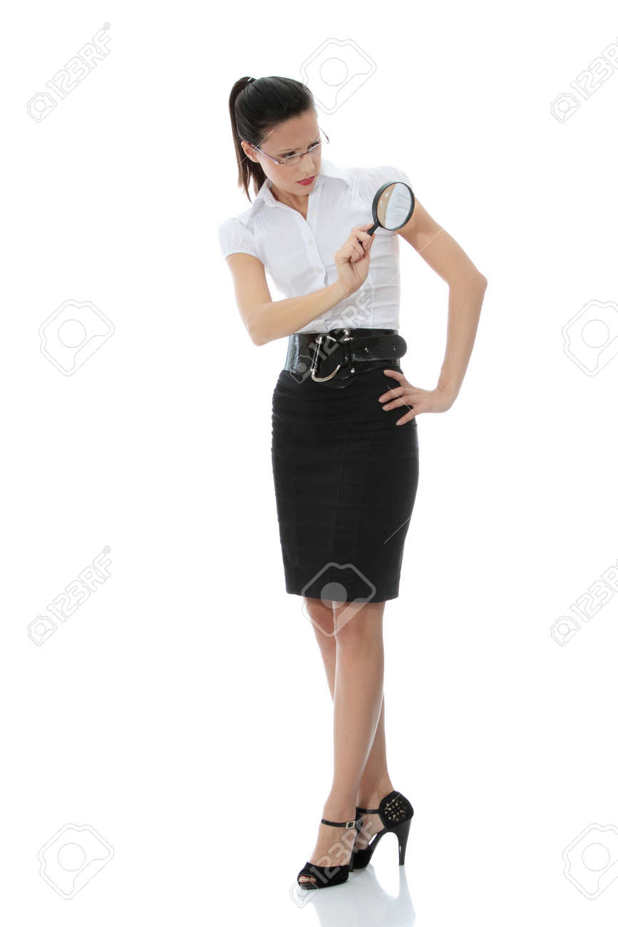 Young attractive business woman looking into a magnifying glass, isolated on white background Standard-Bild - 8719650