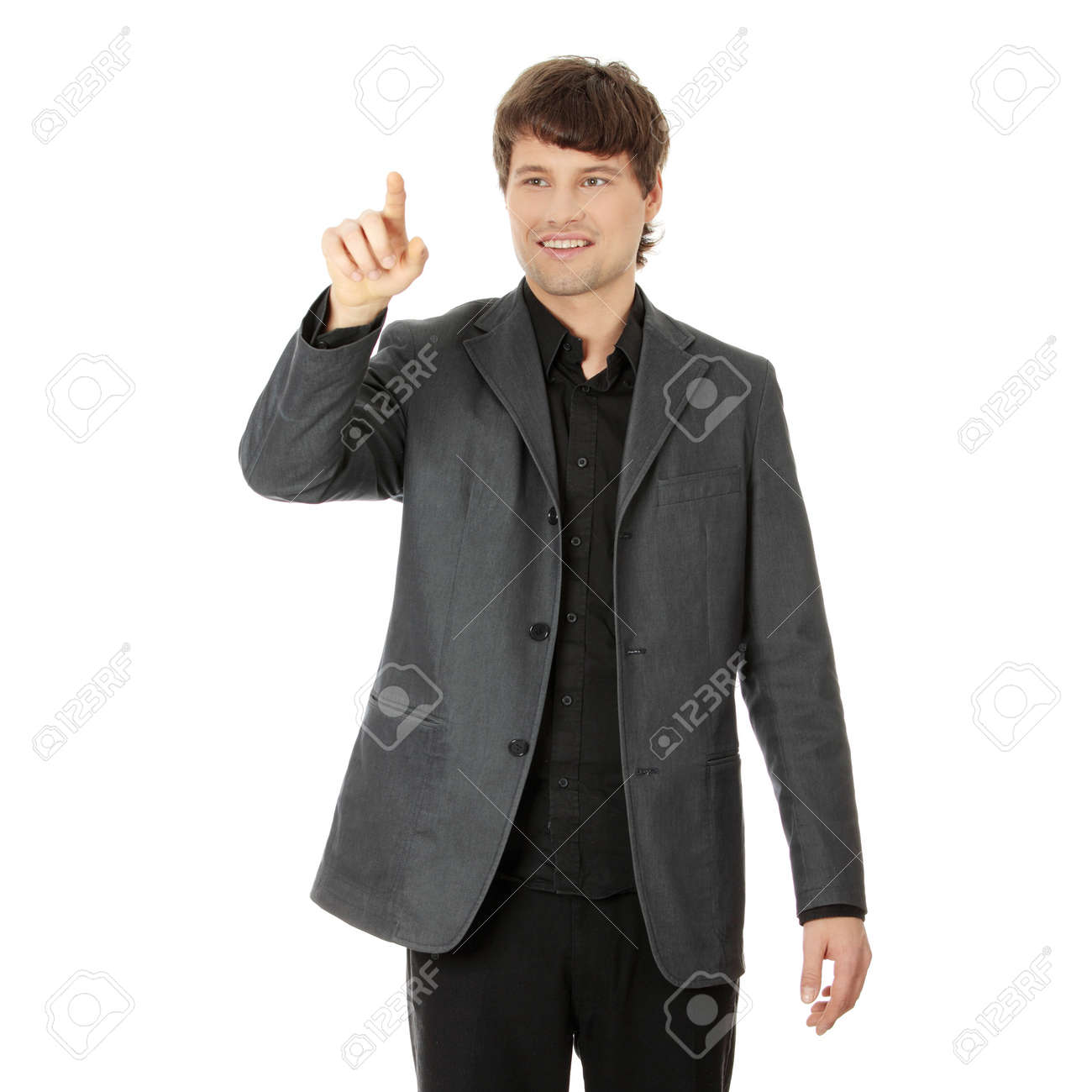 Handsome businessman pressing an abstract touchscreen button isolated on white Stock Photo - 8829286
