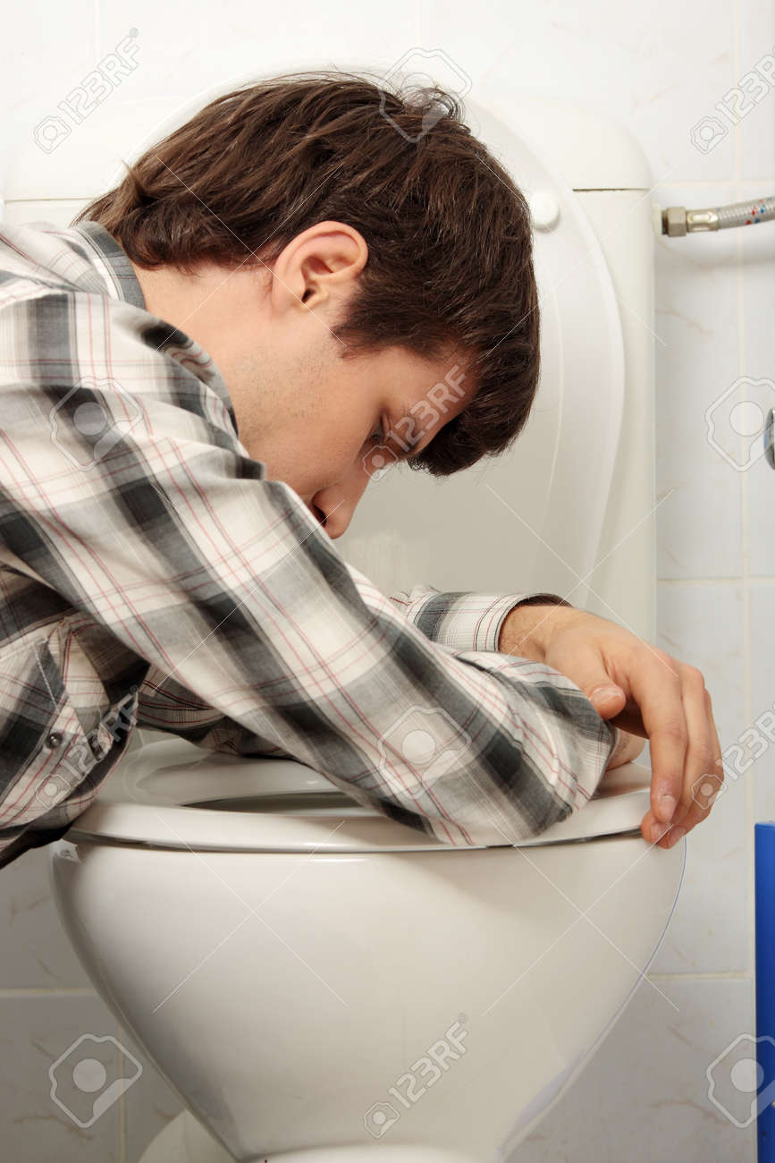 Young man (drunk or sick) vomiting Stock Photo - 8830486