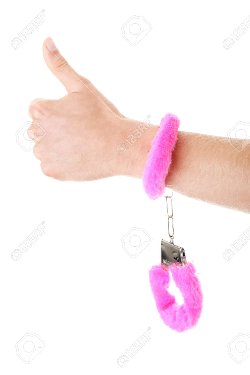 Young caucasian man hand with pink handcuff Stock Photo - 8956372