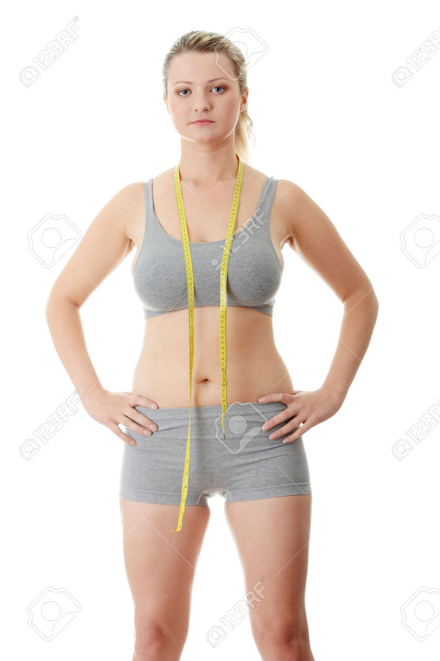 Woman measuring her waist isolated on white Stock Photo - 9013206