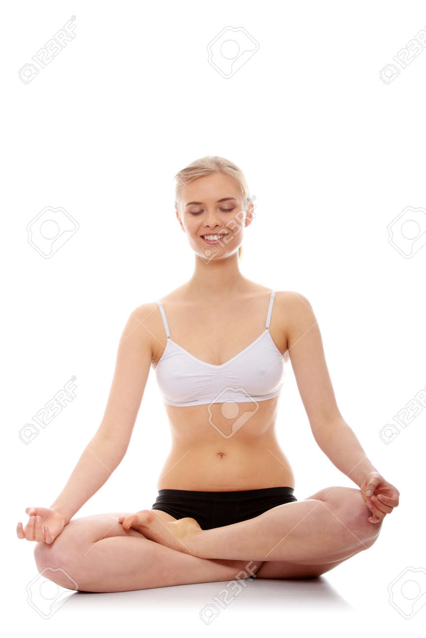 Young woman doing yoga exercise, isolated on white background Stock Photo - 9001293