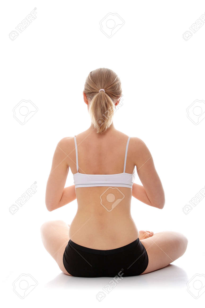 Young woman doing yoga exercise, isolated on white background Stock Photo - 9001334