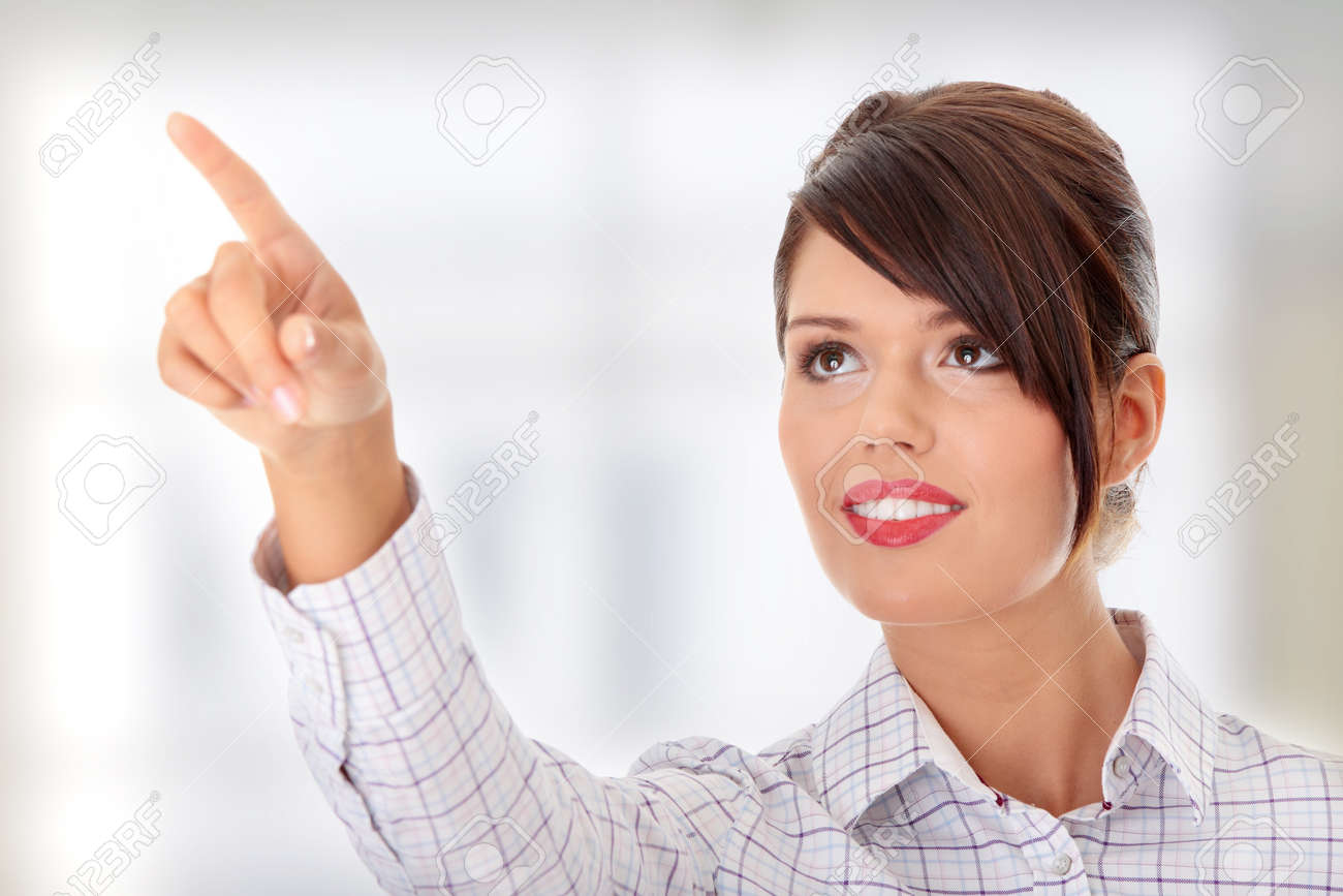 Young beautiful businesswoman making choose on abstract screen Stock Photo - 9015769