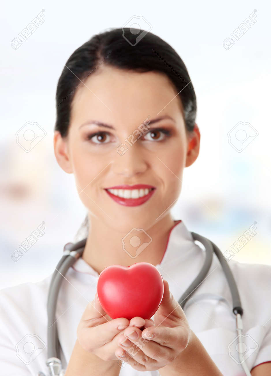 Young doctor with heart in her hand Stock Photo - 9007872