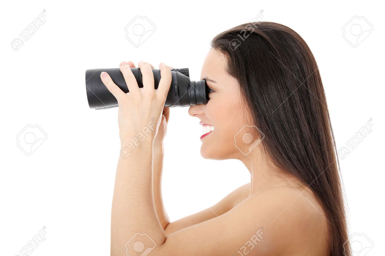 Young happy woman with binocular,   isolated on white Stock Photo - 9031107