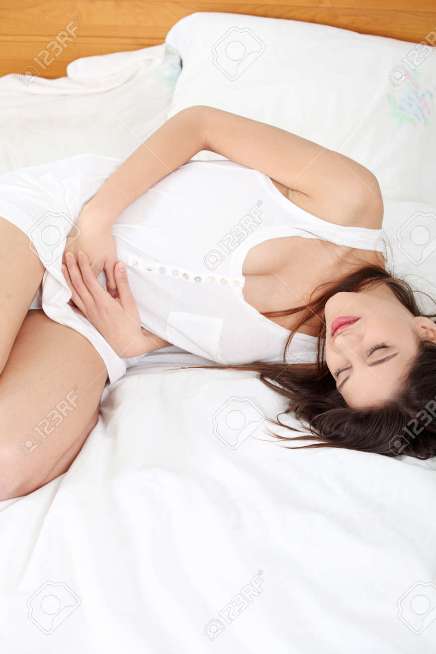 Young woman stroking her belly becouse of bellyache Stock Photo - 9035103