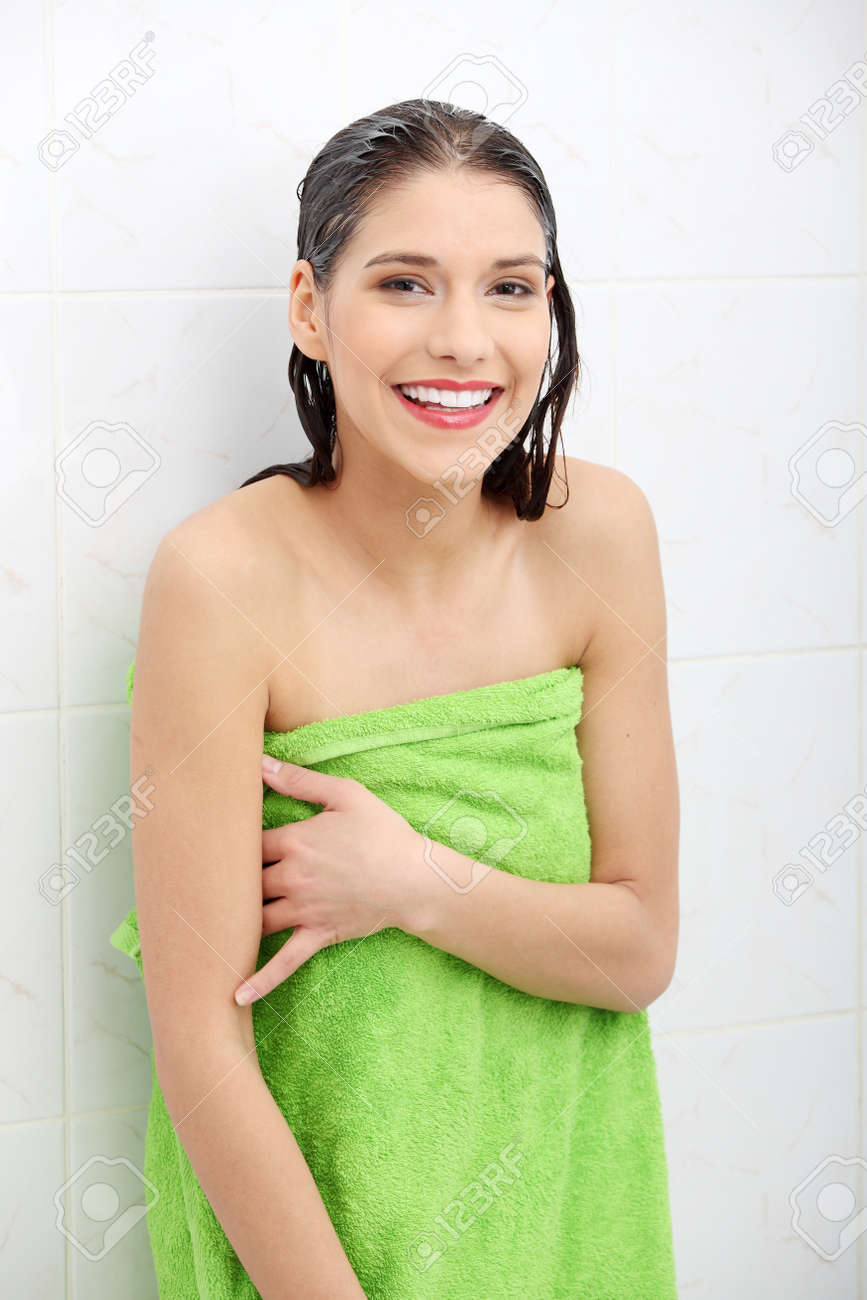 Beautiful woman wipes her wet body with a towel at bathroom Stock Photo - 9035790