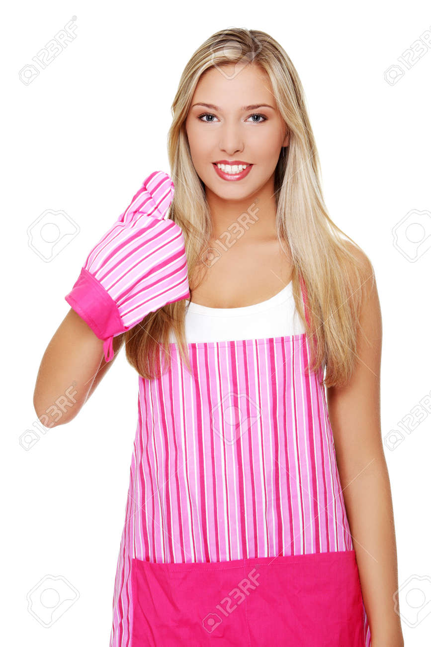Beautiful happy young blond woman wearing kitchen apron and gesturing thumbs up, isolated on white Stock Photo - 10601731