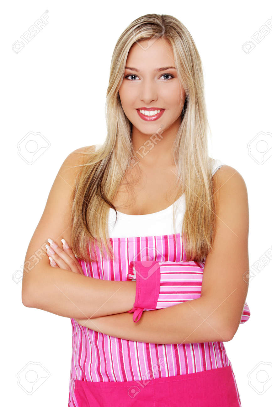 Beautiful happy young blond woman wearing kitchen apron, isolated on white Stock Photo - 10601736