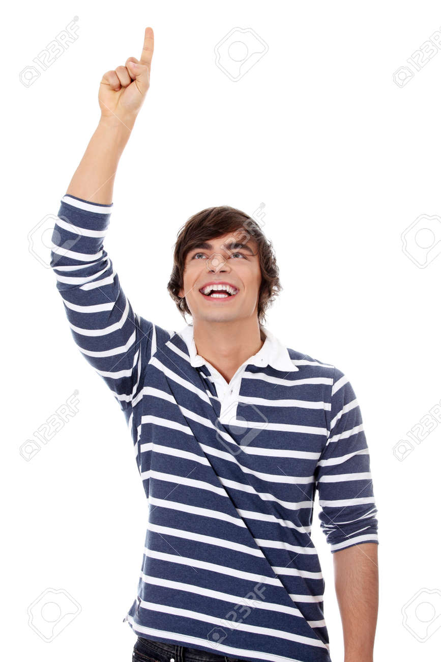 Young happy handsome man pointing up with his finger Stock Photo - 11267875