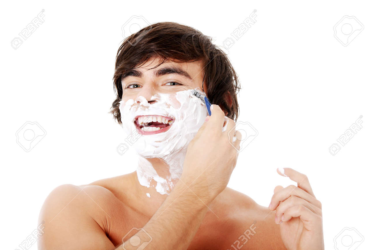 Portrait of young handsome man shaving Stock Photo - 11267862