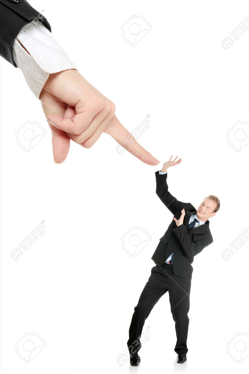 Scared young businessman afraid of big hand pointing on him, isolated on white Stock Photo - 13187338