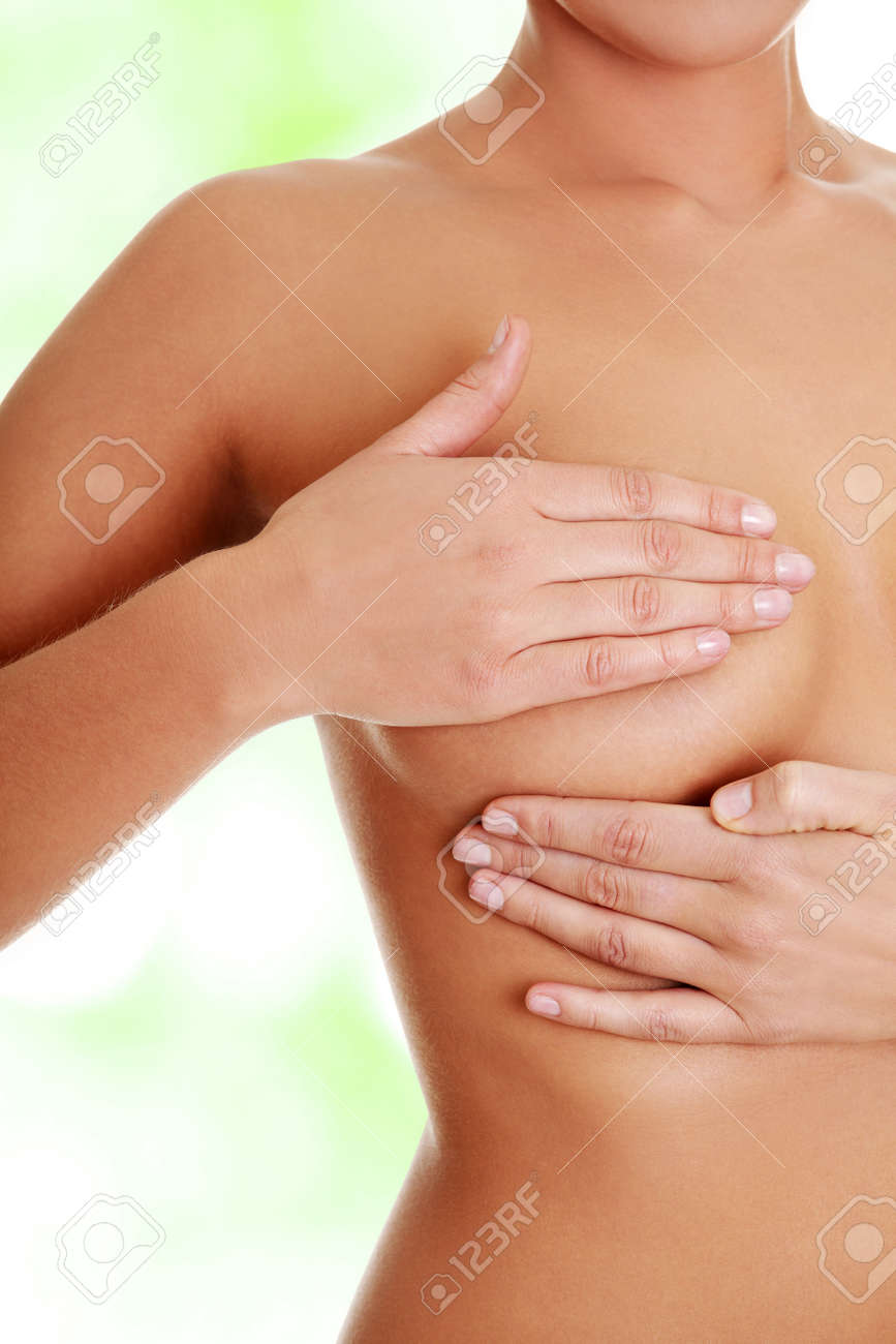 Stock Photo - Young Caucasian adult woman examining her breast for lumps or  signs of breast cancer