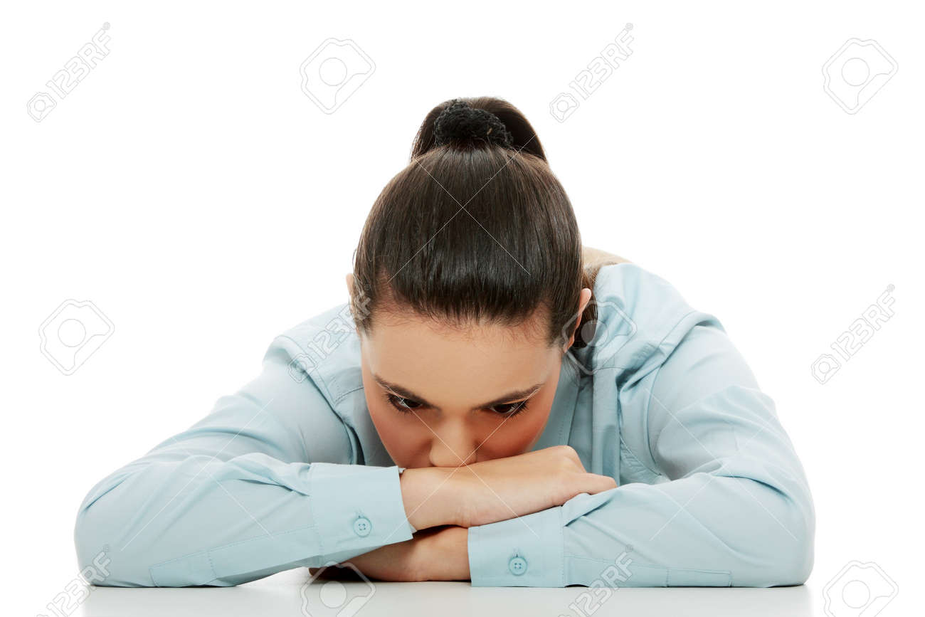 Young sad woman, have big problem or depression, over white background Stock Photo - 16677872
