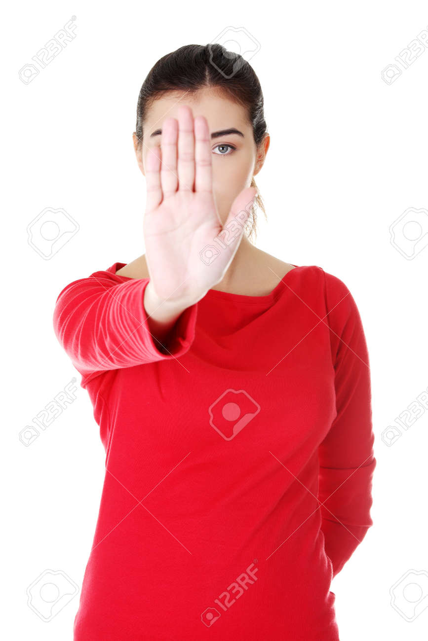 Hold on, Stop gesture showed by young woman hand Stock Photo - 16774250