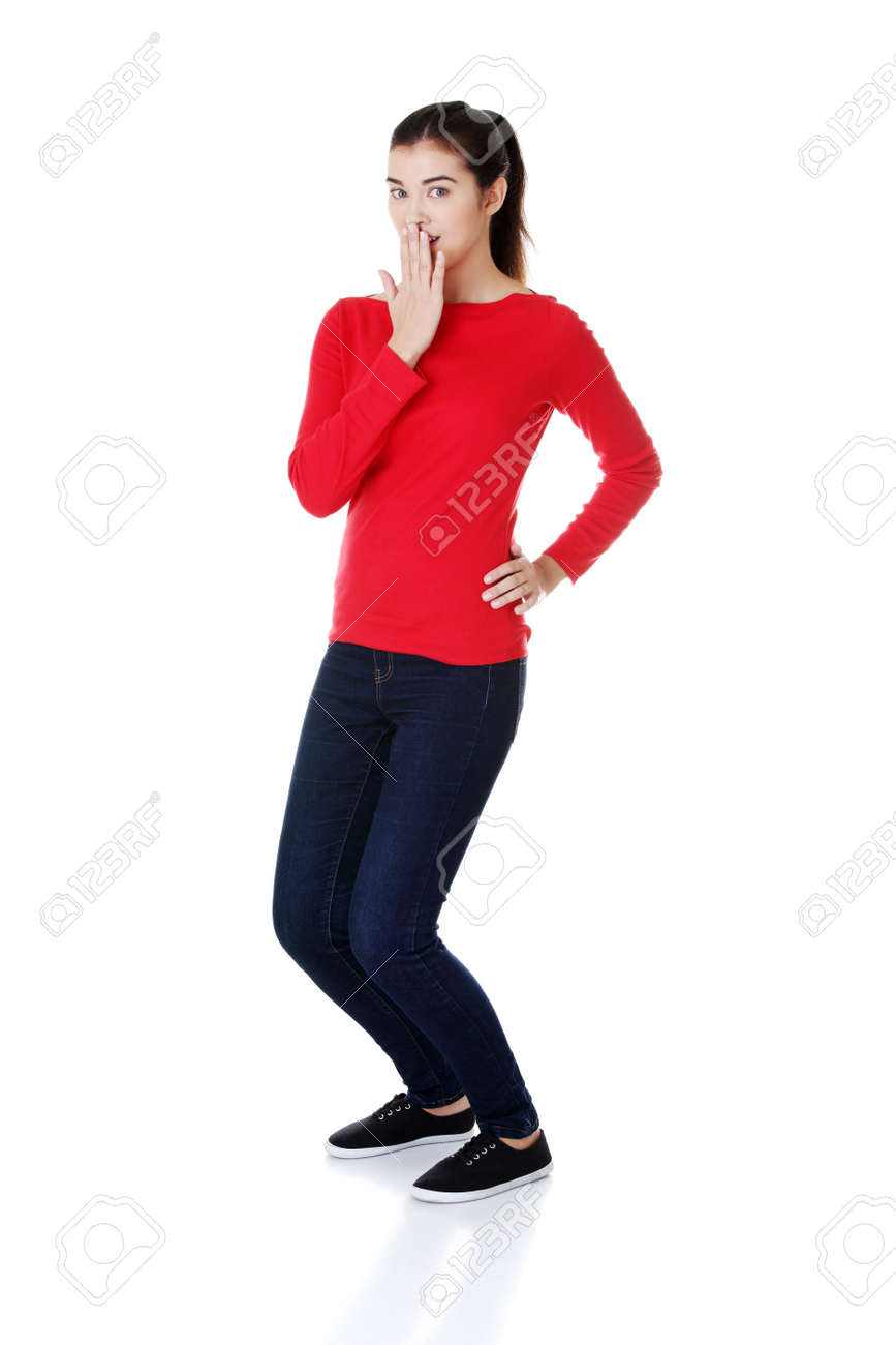 Shocked woman covering her mouth with hand, isolated on white Stock Photo - 16771483