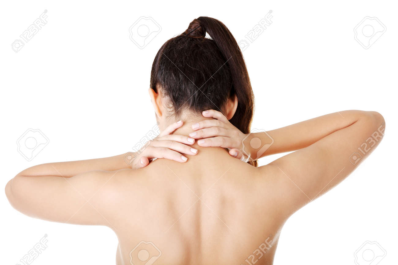 Young woman with pain in her back. Isolated on white Stock Photo - 16772567
