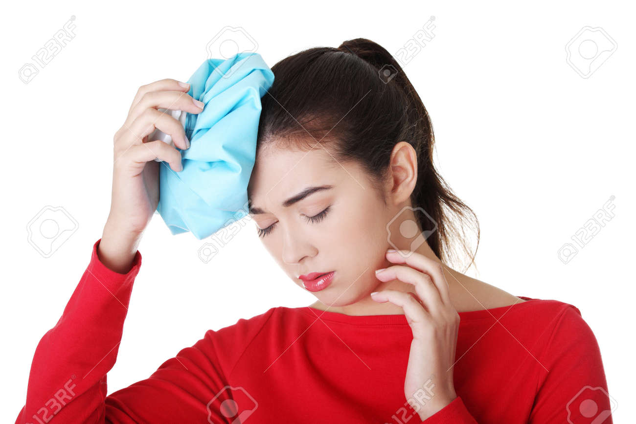 Woman with ice bag for headaches and migraines , isolated on white Stock Photo - 16917813
