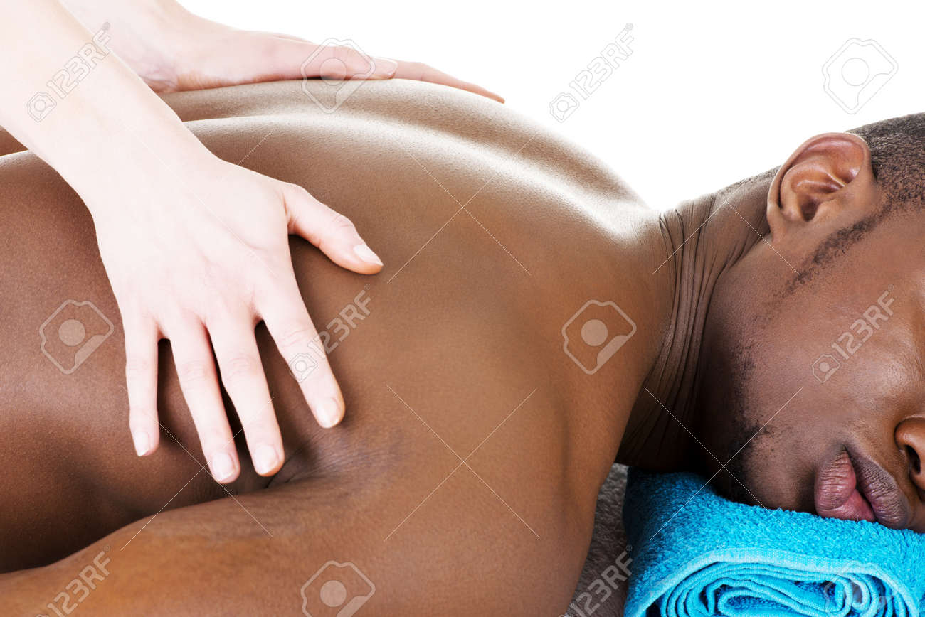 Masseur doing massage on man body in the spa salon. Stock Photo - 19124259