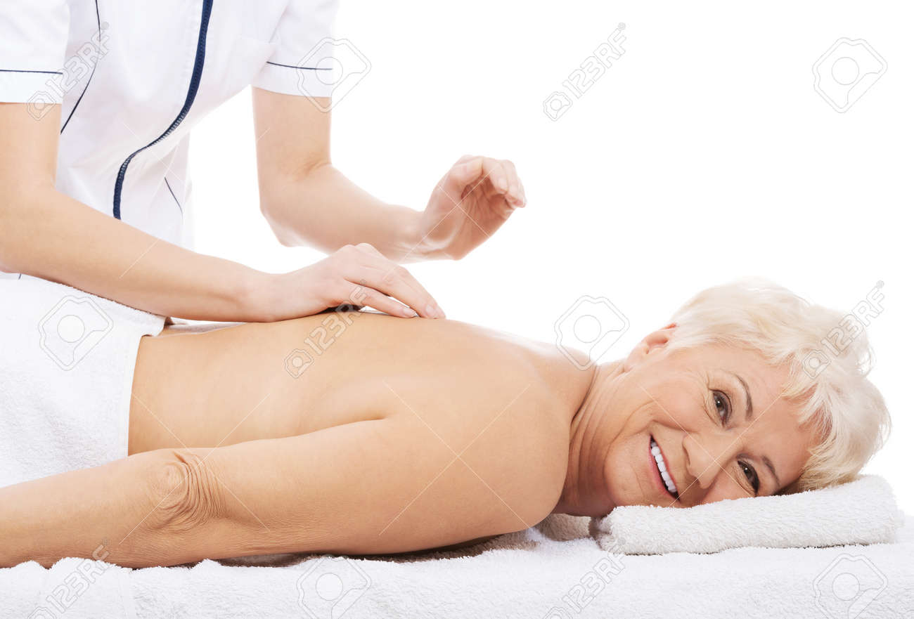 Old woman is having a massage. Spa concept. Stock Photo - 28857904