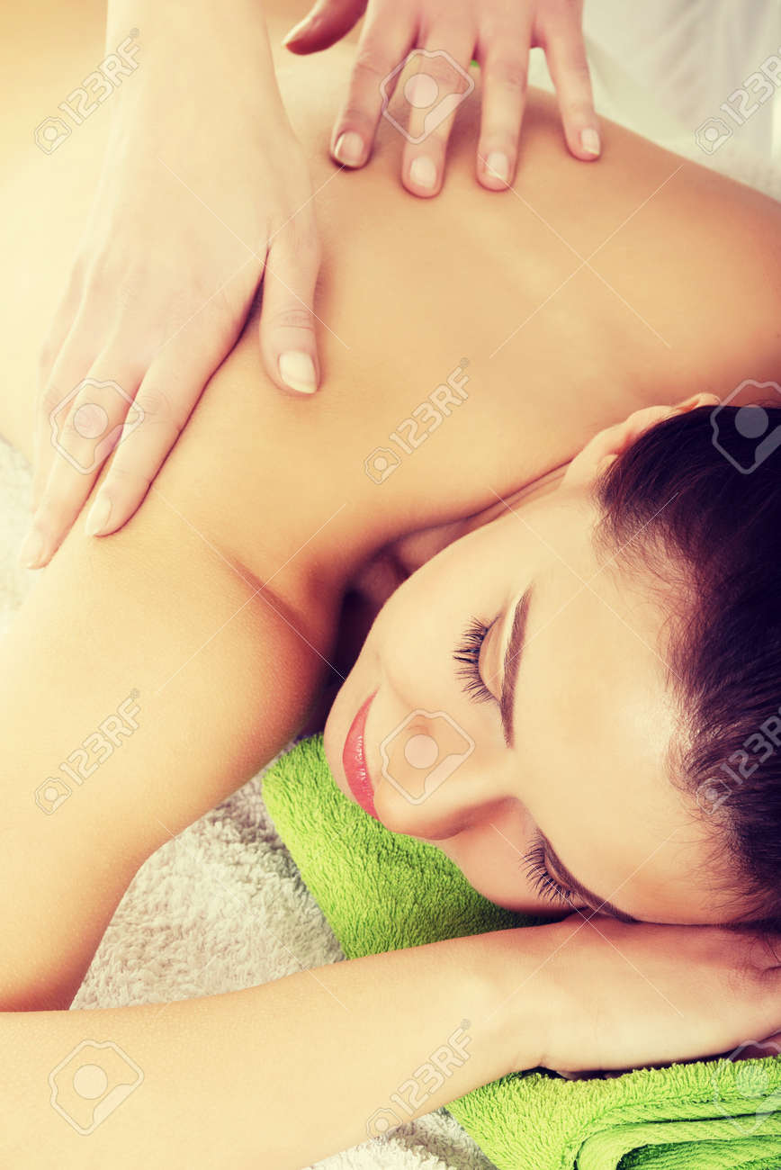 Beautiful woman lying on bed in spa salon having massage. Spa concept. Stock Photo - 29319501