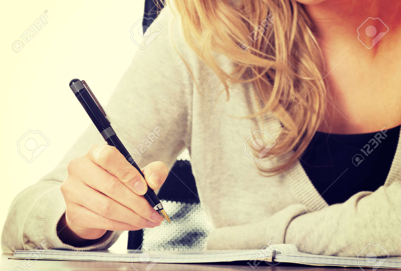 Handwriting, hand writes with a pen in a notebook - 36534201