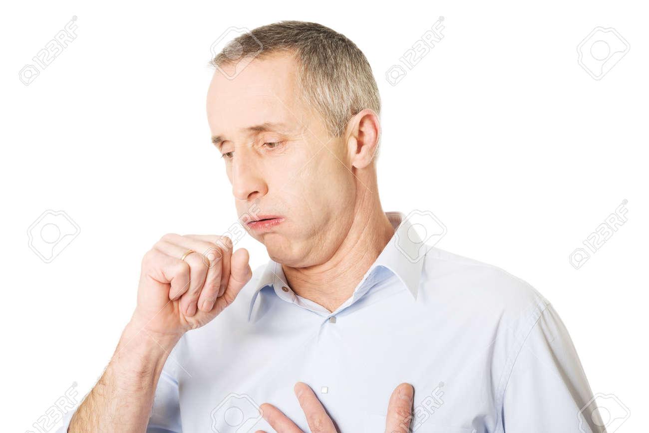 Mature man coughing because of flu. - 36708950