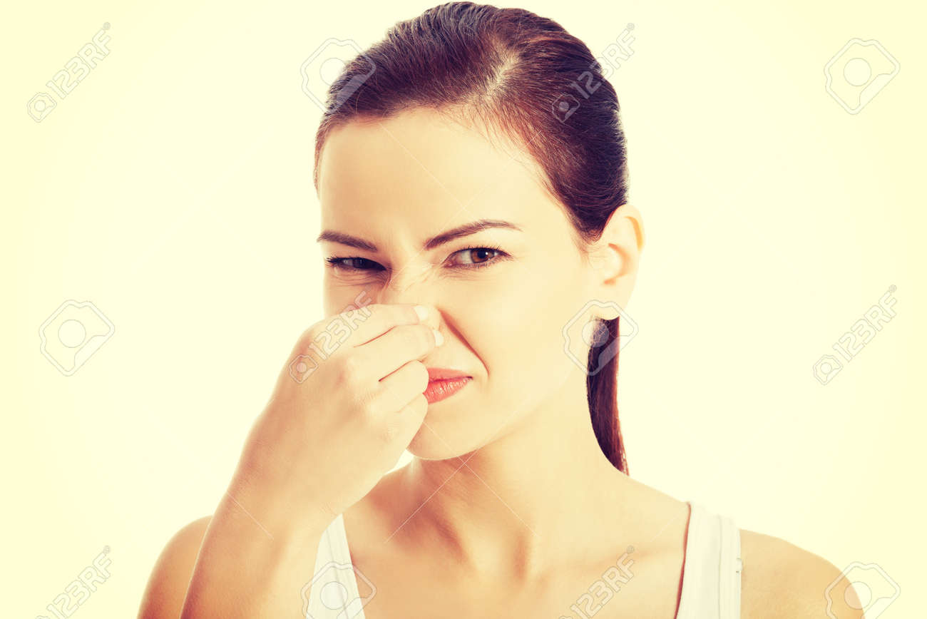 Woman pinches her nose to block a bad smell. - 37278734