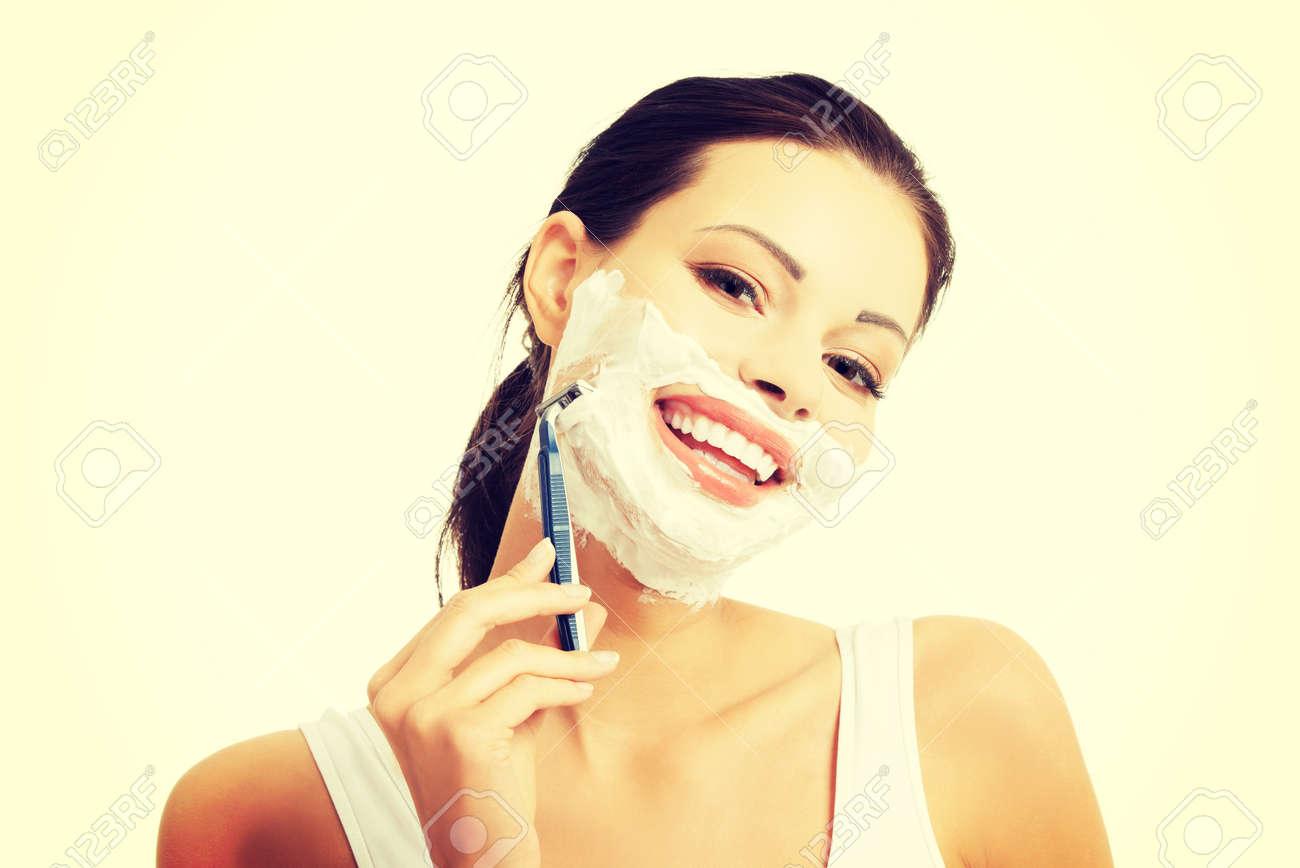 Portrait of happy woman shaving beard. - 39754583