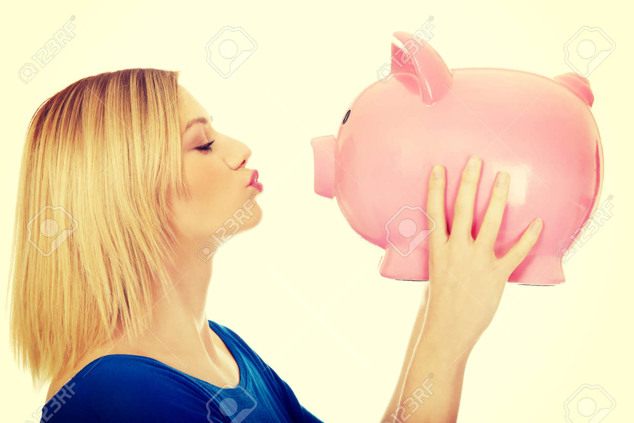 Happy casual woman kissing a piggybank. - 51116203