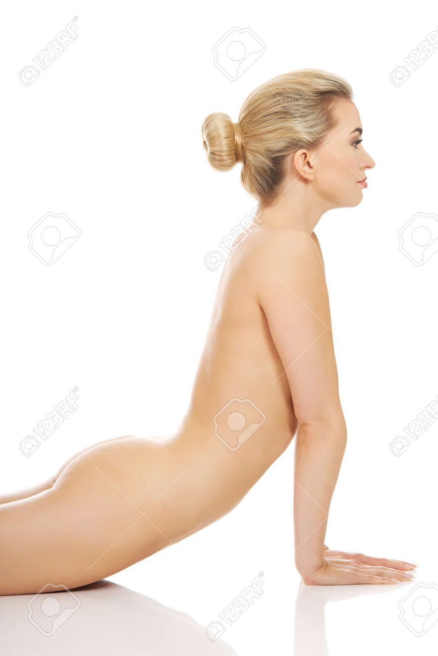 Stock Photo - Young slim nude woman in yoga pose.