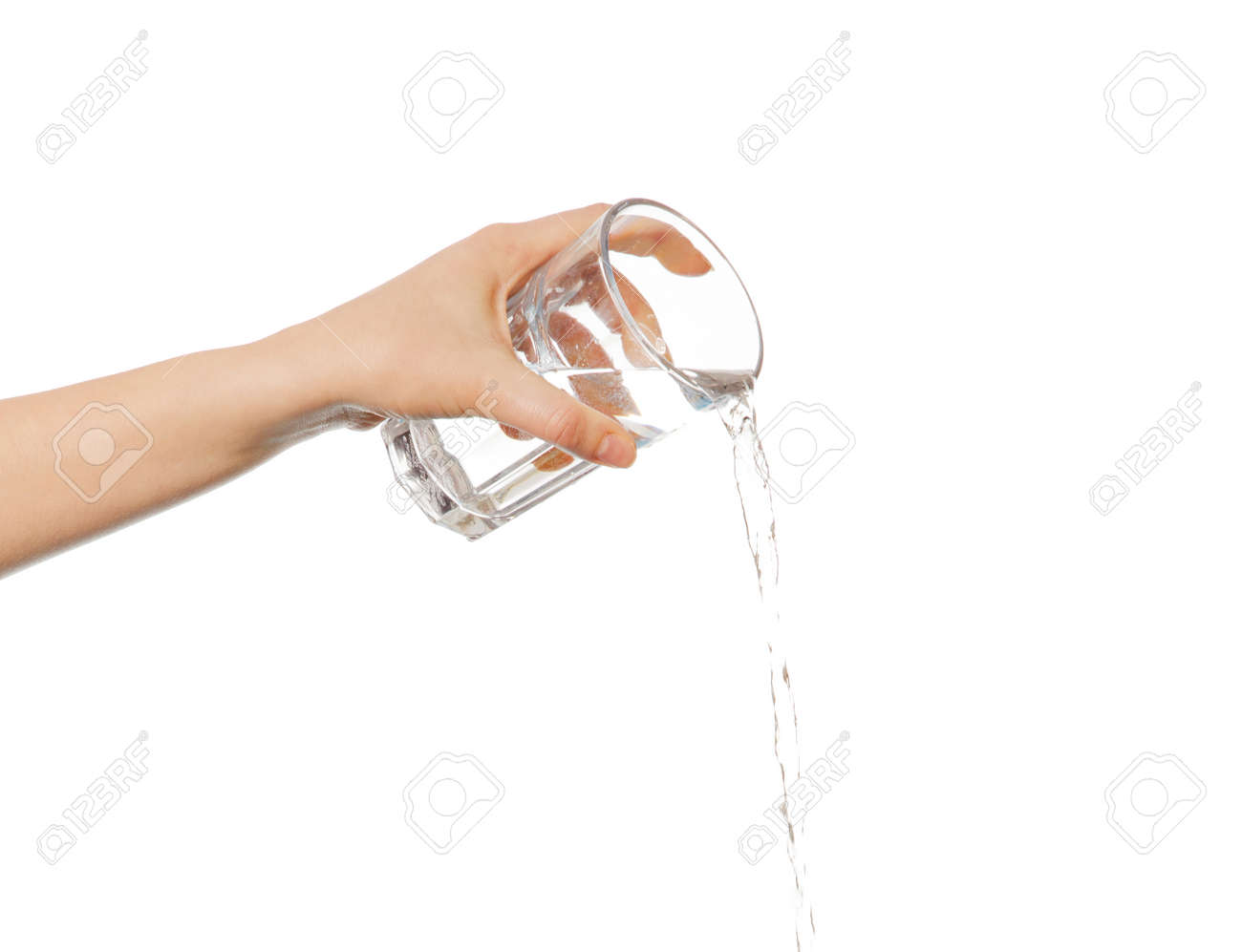 Hand pouring water from glass. - 58109799