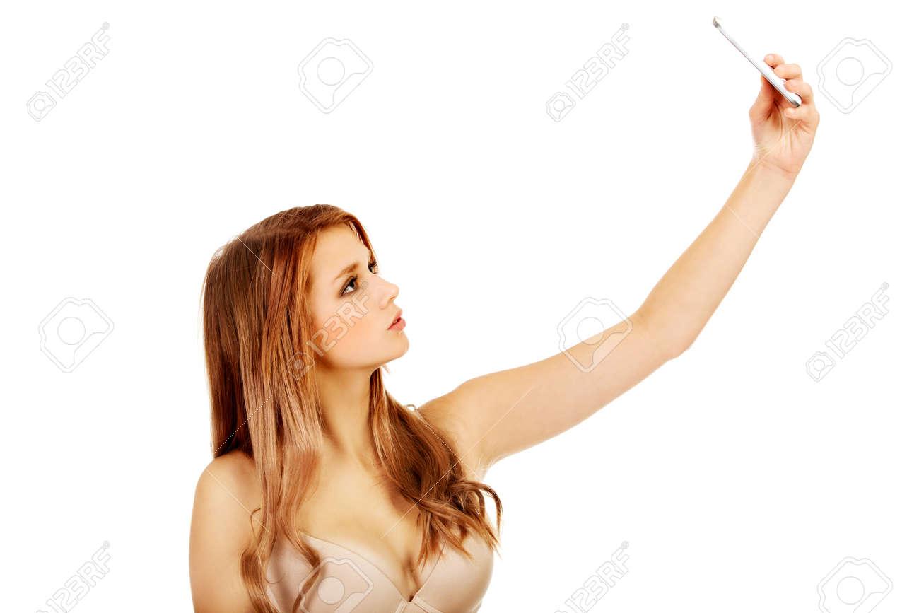 teenage woman in underwear makes photo of herself stock photo