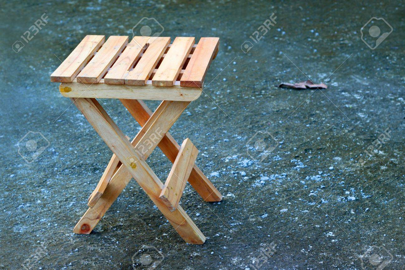 Lonely wooden folding stool Stock Photo - 8038990