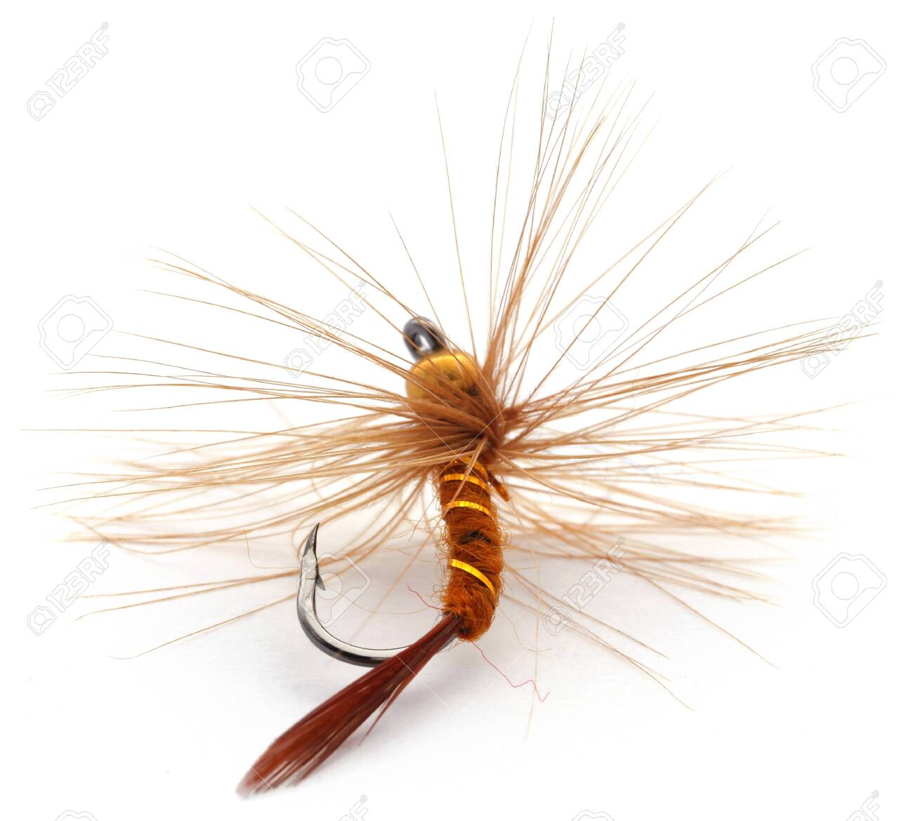 Hand made fishing fly with hook over white background - 130329973