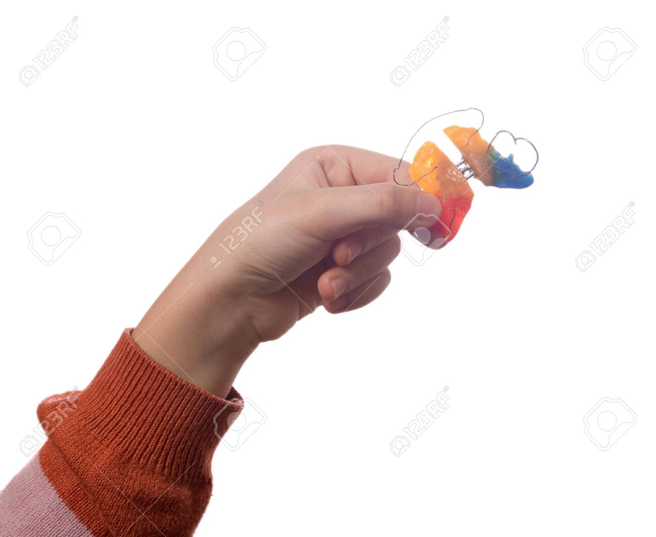 Child's hand with orthodontic appliance isolated on a white background - 146946344